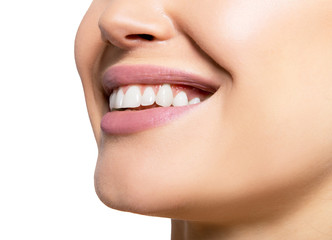Smiling happy woman. Laughing female mouth with great teeth over white background. Healthy beautiful smile. Teeth health, whitening, prosthetics and care.