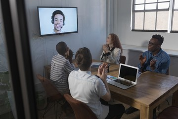 Business people applauding during video call in conference