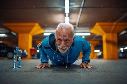 Portrait of senior man doing push ups