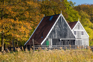 Historic Dutch scene with a wooden barn in the open air museum in Arnhem in the Netherlands