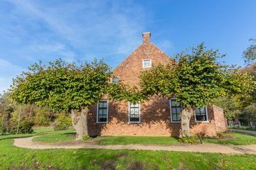 Idyllic Dutch farmhouse typical for the northern province of Groningen in the Netherlands