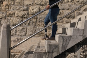 Disabled woman descending stairs