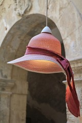 Upcycling of a hat as a lampshade, Italy