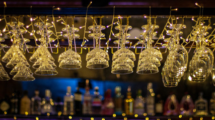 Glassware hanging above a bar