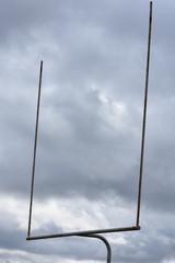 Football goalposts against a cloudy sky