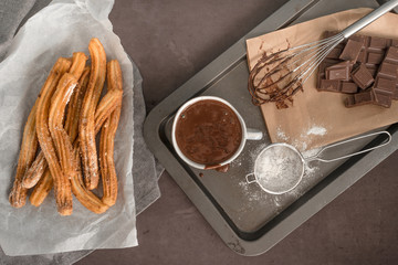 Traditional Spanish and Mexican dessert churros with hot chocolate sauce