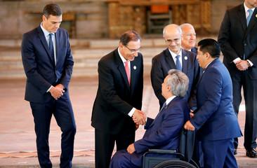 Peru's President Martin Vizcarra shakes hands with Ecuador's President Lenin Moreno before a group  photo during the XXVI Ibero-American Summit in Antigua Guatemala