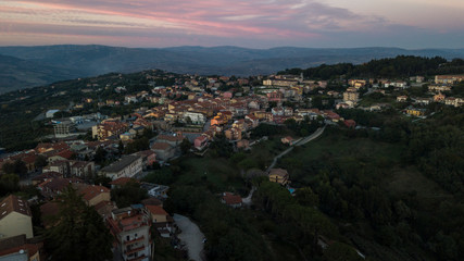 Aerial view at sunset of the small town of Montecalvo Irpino, in the province of Avellino, in Italy. This village with few houses and streets is built in the mountains of Irpinia.