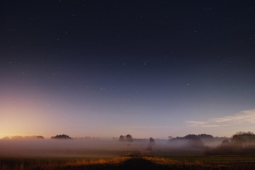 Beautiful night view nature landscape with stars and fog environment in the countryside. Braunschweig, Germany