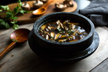 Close up of tofu and mushroom soup served in dolsot