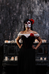 Portrait of zombie woman with white face and red flower on her head