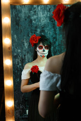 Picture of zombie woman with white face , red flower on her head