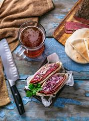 Pastrami beef sandwich wit coleslaw salad, copy space.