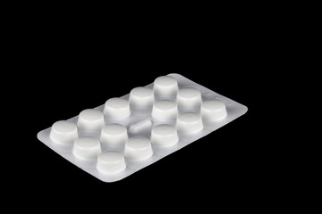 Pack of Medicine Tablets on a Black Background