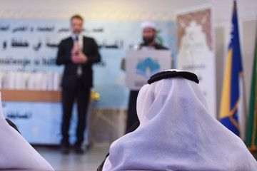 Islamic conference, imam, muslim's leaders at the islamic and arabic business and religious conference