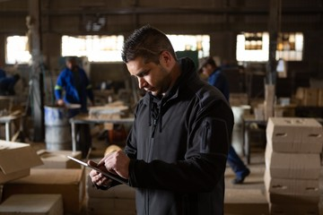 Man using digital tablet in foundry