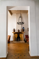 Fireplace and hanging light fixture