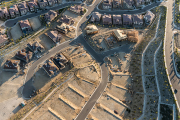 Aerial view of new streets, homes and graded lots near Los Angeles, California.