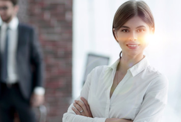 portrait of young business woman on the background of the office