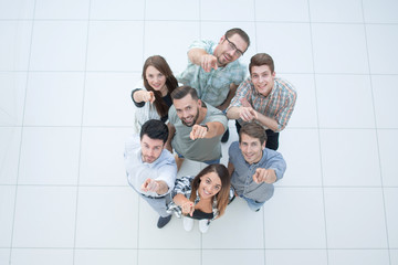 top view.a group of successful young people pointing to you