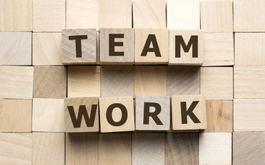 Teamwork word made from wooden cubes blocks with letters alphabet