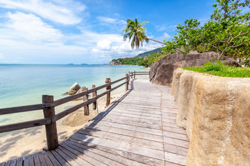 Wall Mural - Bright beautiful tropical landscape, wooden walkway along the seashore