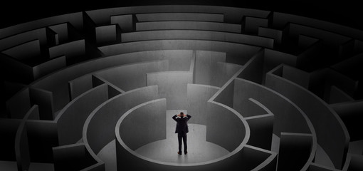 Businessman can not decide which entrance to chose in a middle of a dark maze