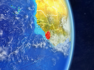 Sierra Leone on planet planet Earth with country borders. Extremely detailed planet surface and clouds.