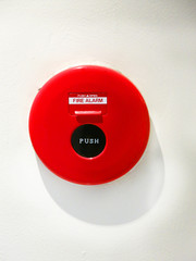 Fire alarm isolate in white wall.