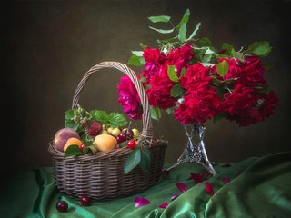Still life with bouquet of beautiful flowers and fruit basket