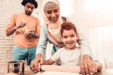 Happy Arabian Family Cooking Food in Kitchen.