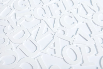 White wooden alphabet letters top view on white background