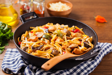 Indonesian pasta with chicken, pieces of bamboo and mushrooms.