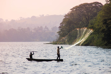 Fisherman throws a net in Lake Victoria. Wall mural