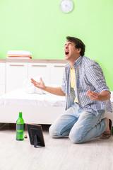 Young man sad in unhappy love concept