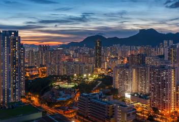Fototapete - Panorama of Hong Kong City skyline and Lion Rock Hill at dusk