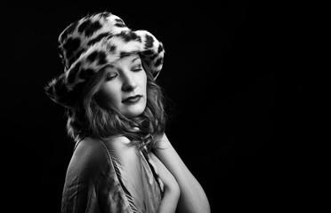 Fashion studio portrait of beautiful lady in fur hat. Winter beauty