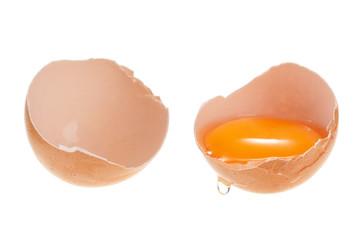 Broken chicken egg isolated on white background.