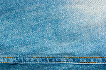 Blue washed faded jeans texture with seams