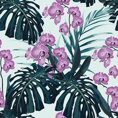 Seamless pattern, violet orchid flower and green blue exotic palm monster leaves on mint background. Vintage style.