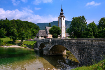 Church of St John the Baptist with bridge. Lake Bohinj. Triglav National Park, Julian Alps, Slovenia