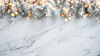 Christmas background with xmas tree on white marble background. Merry christmas greeting card, frame, banner. Winter holiday theme. Happy New Year.