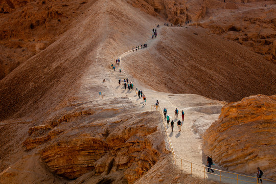Line of tourists climbed on Masada fortrees rock. Israel.
