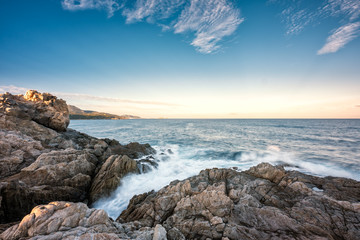 Waves washing onto rocky coast of Corsica