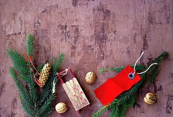 Merry Christmas and Happy New Year holidays, festive background with fir branches, walnuts and Christmas decorations. Top view