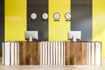 Wooden reception in black yellow office