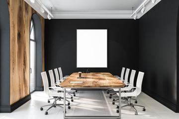 Black meeting room with poster