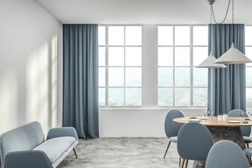 White cafe interior with blue sofa
