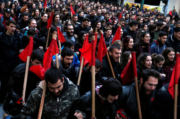 Protesters shout slogans as they march to the U.S. embassy during a rally marking the 45th anniversary of a 1973 student uprising against the military dictatorship that was ruling Greece, in Athens