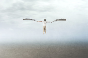 Obraz man with wings flying in the sky - fototapety do salonu